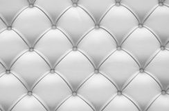 Abstract white background. Padding white leather rhombus and buttons Stock Images
