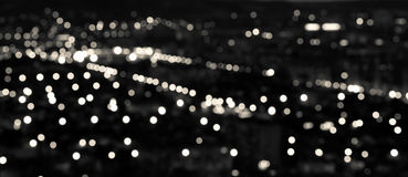 Abstract white black circular bokeh background, city lights in t Royalty Free Stock Photo