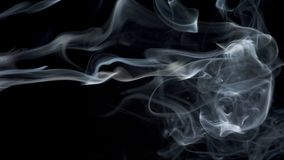 Abstract white blue smoke waves slow moves on the black background stock video