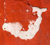 Abstract white figure at a red plaster Royalty Free Stock Images