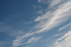 Abstract white fluffy clouds in the blue sky Stock Photos