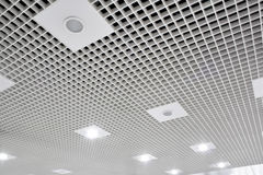 Abstract white geometric ceiling. In office center Royalty Free Stock Photo