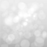 Abstract white and gray bokeh lights background. Artistic style - Defocused abstract white and gray bokeh lights background with blurring lights for your design Royalty Free Stock Photo