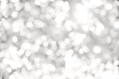 Abstract white and gray bokeh lights background. Artistic style - Defocused abstract white and gray bokeh lights background with blurring lights for your design Royalty Free Stock Photos