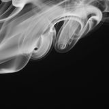Abstract white, gray smoke on black background Stock Images