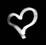 Abstract white heart on black background royalty free stock images