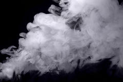 Abstract white smoke against dark background Royalty Free Stock Image