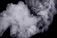 Abstract white smoke against dark background Royalty Free Stock Photos