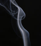 Abstract. White smoke over black background Royalty Free Stock Photography