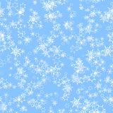 Abstract white snowflakes on light blue background.  Seamless illustration. Abstract snowflakes on light blue background Stock Photos