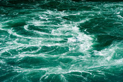 Abstract white water currents in green river Stock Photo