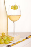 An abstract with white wine. Grapes, cheese and olives Royalty Free Stock Image