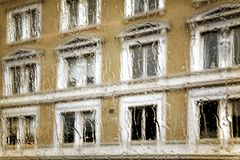 Abstract windows view trough wet glass Royalty Free Stock Image