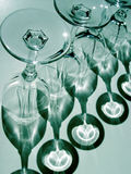 Abstract wine glasses. In teal stock images
