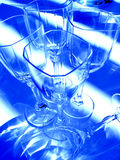 Abstract wine glasses. In blue royalty free stock photos