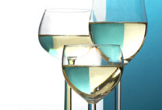 Abstract wine glasses, background half blue, half white, copy sp Royalty Free Stock Photo