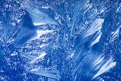 Abstract Winter background. Christmas abstract frostwork on a window glass Stock Images