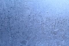 Abstract winter background. Frost patterns on window. Empty space for text Royalty Free Stock Photo