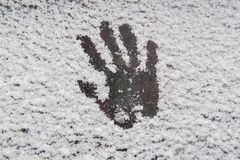 Abstract winter background, interesting handprint on white snow. royalty free stock photo