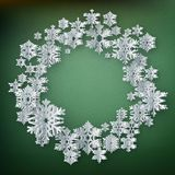 Abstract winter background with paper snowflakes on green background. EPS 10 royalty free illustration