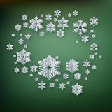 Abstract winter background with paper snowflakes on green background. EPS 10 vector illustration