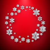 Abstract winter background with paper snowflakes on red background. EPS 10 vector illustration