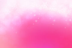 Abstract winter background, snow flakes falling on pink gradient Royalty Free Stock Photography