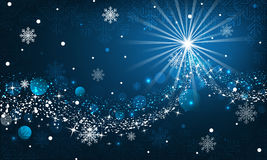 Abstract winter background. Snowfall, sparkle, snowflakes on a blue dark background. Royalty Free Stock Images