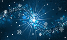Abstract winter background. Snowfall, sparkle, snowflakes on a blue dark background. Stock Image