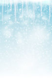 Abstract winter background with snowflakes and icicles Royalty Free Stock Images