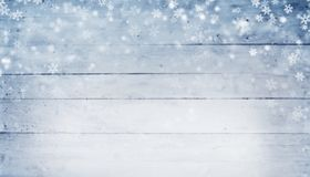 Abstract winter background with wooden planks and snow flakes. Free space for text Royalty Free Stock Photo