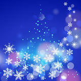 Abstract winter blue background with snowflakes an Stock Photography