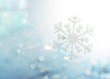 Abstract winter blue bokeh snowflake background Stock Photos
