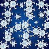 Abstract winter blue snowflakes Stock Images