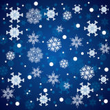 Abstract winter blue snowflakes. Background Stock Images