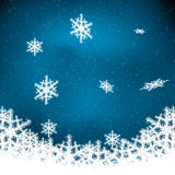 Abstract winter blue snowflakes Stock Photos