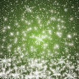 Abstract winter green snowflakes background Stock Images