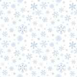 Abstract winter seamless pattern. With blue snowflakes on white background. Can be used for wallpaper, wrapping, textile, web page background, greeting cards Royalty Free Stock Image