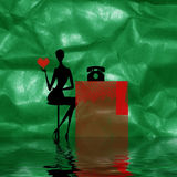 Abstract of woman with heart. An abstract view of the outline of a woman seated at a desk with a telephone on it, holding a red valentine heart.  Green Stock Images