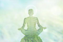 Abstract woman meditation in the soft nature background and energy on the head, exposure concept stock photo