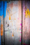 Abstract wood background with streaks of color paint Royalty Free Stock Photography