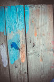 Abstract wood background with streaks of color paint Royalty Free Stock Image
