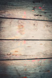 Abstract wood background with streaks of color paint Royalty Free Stock Photos