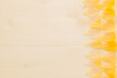 Abstract wood background with yellow flower petals. Background. Pattern. Stock Photo