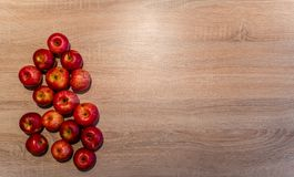 Abstract Wooden Background with the Apples on the one Side with Space for Text stock image