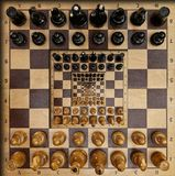Abstract wooden chess board desk white black figures square surreal effect. Pattern effect Surreal chess board desk fractal backgr Stock Images