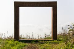 Abstract wooden doorway in the meadow Royalty Free Stock Image