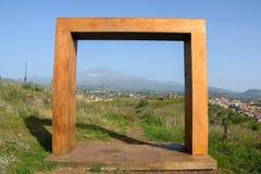 Abstract wooden doorway in the meadow Stock Image