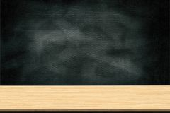 Abstract wooden table texture and chalk rubbed out on blackboard, for graphic add product, Education concept, Royalty Free Stock Images