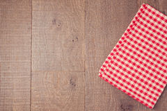 Abstract wooden texture background with red checked tablecloth. View from above Royalty Free Stock Image